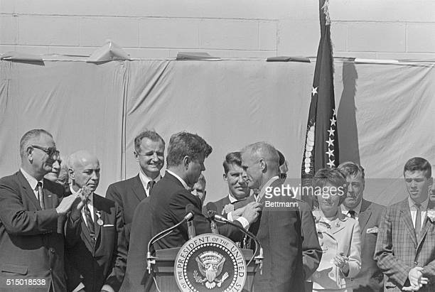 President Kennedy pins the NASA Medal on astronaut John Glenn after Glenn became the first American to orbit the Earth