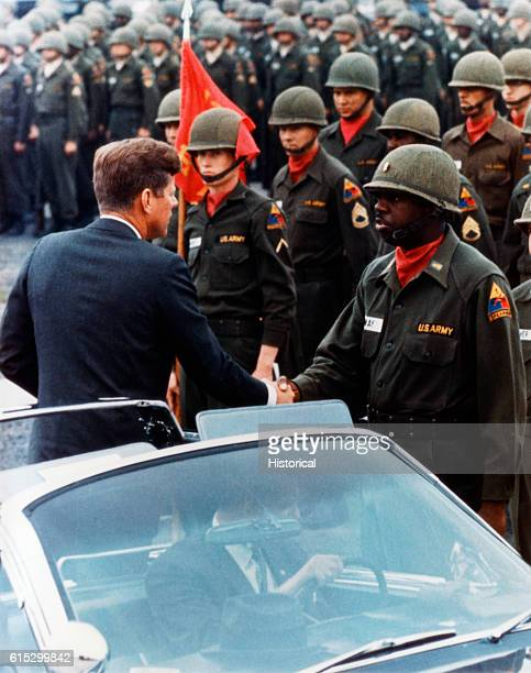 President Kennedy shakes hands with a soldier as he greets the troops in Hanau West Germany June 25 1963