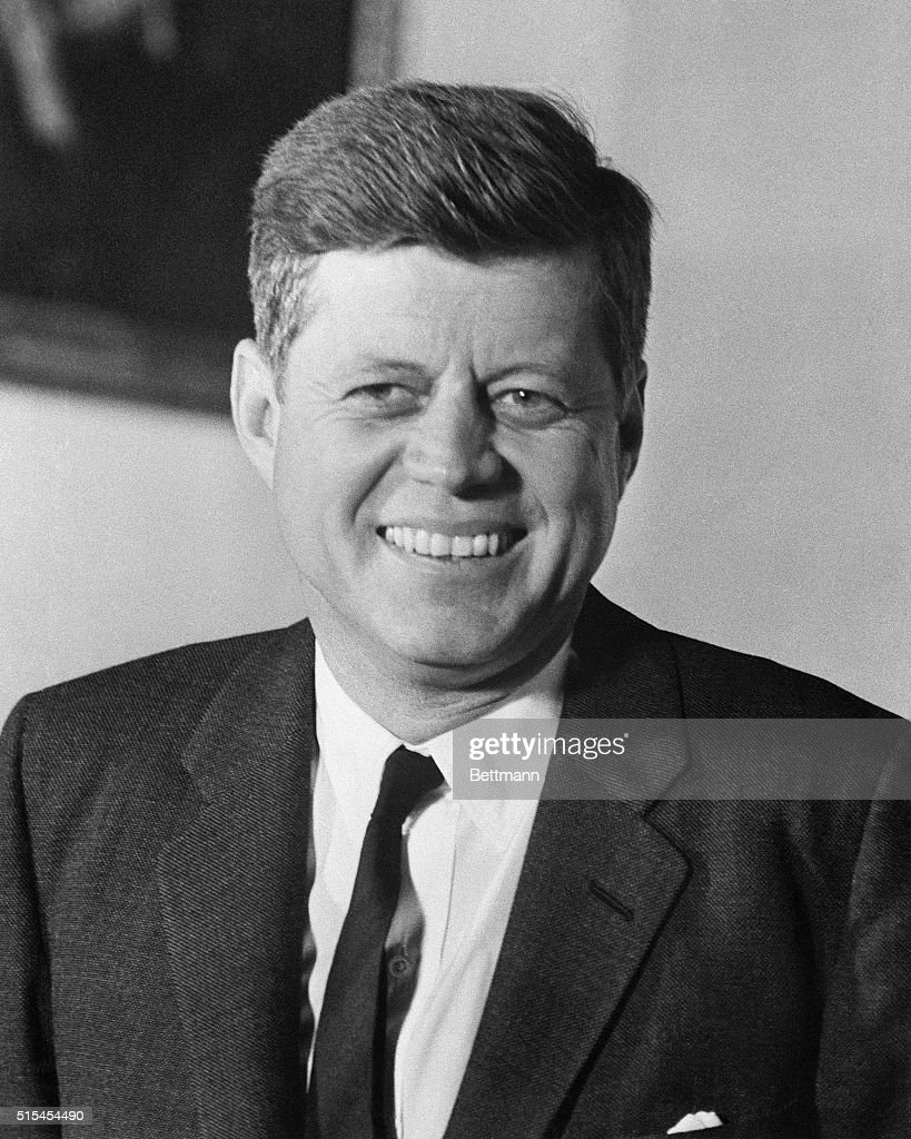 President Kennedy smiles on his first anniversary in the White House.