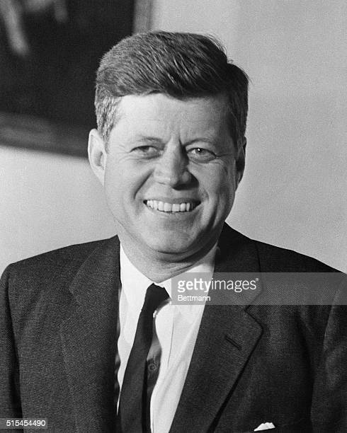 President Kennedy smiles on his first anniversary in the White House