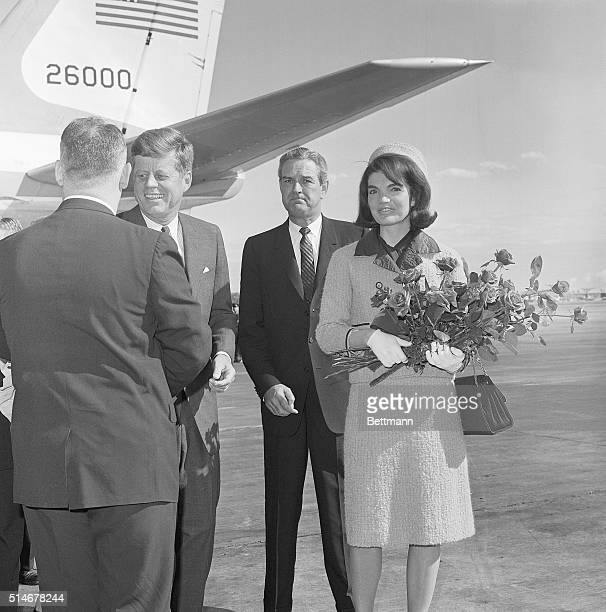 President Kennedy stands on a Texas airstrip with Jackie Kennedy and Governor John Connally on November 22, 1963. Later that day, both the president...