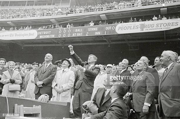 President Kennedy tosses out the first ball to officially open the 1962 baseball season here today Left to right Vice President Lyndon Johnson Dave...
