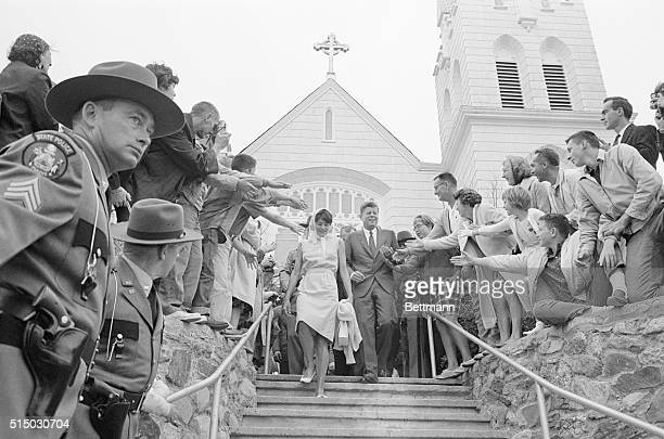 President Kennedy walks down the steps leading away from the Church of Our Lady Queen of Peace with his sister Mrs Patricia Lawford after attending...