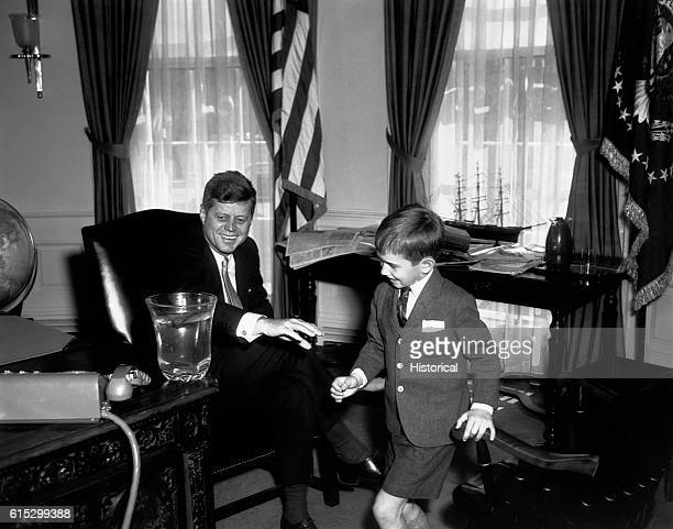 President Kennedy with his nephew, Robert F. Kennedy Jr., in the Oval Office.