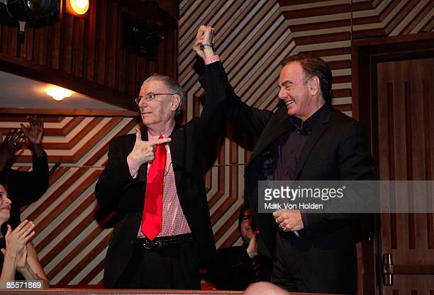 President L Jay Olivia and musical artist Neil Diamond take a bow at the salute to NYU President Emeritus L Jay Oliva celebration at the Skirball...
