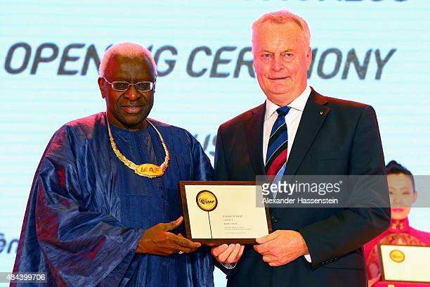 President Lamine Diack hand sover the Plaque of Merit to Karel Pilny during the IAAF Congress Opening Ceremony at the Great Hall of the People at...