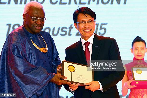President Lamine Diack hand sover the Plaque of Merit to Tigor Mangapul Tanjung during the IAAF Congress Opening Ceremony at the Great Hall of the...