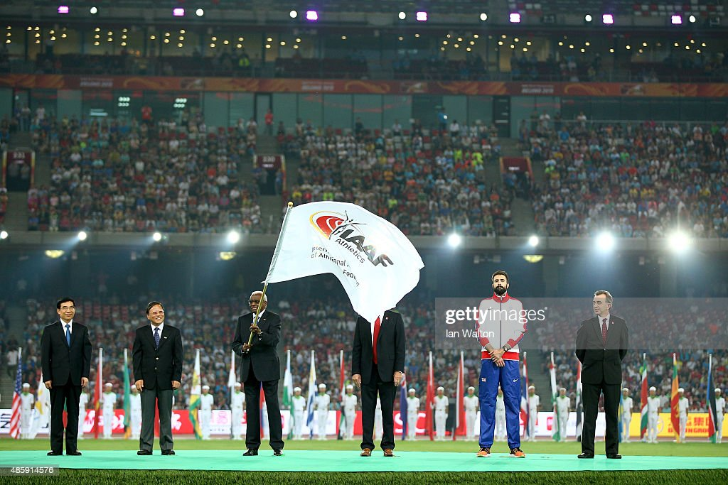 President Lamine Diack hands over the IAAF flag during the closing ceremony during day nine of the 15th IAAF World Athletics Championships Beijing 2015 at Beijing National Stadium on August 30, 2015 in Beijing, China.