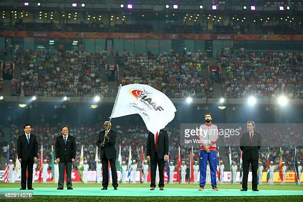 President Lamine Diack hands over the IAAF flag during the closing ceremony during day nine of the 15th IAAF World Athletics Championships Beijing...