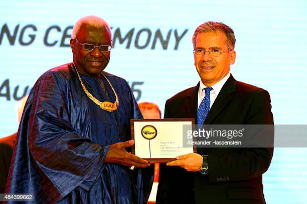 President Lamine Diack hands over the Plaque of Merit to Lino Ramiro Varela Marmolejo during the IAAF Congress Opening Ceremony at the Great Hall of...