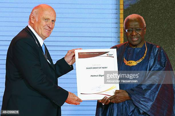 President Lamine Diack hands over the Silver Order of Merit to Helmut Digel during the IAAF Congress Opening Ceremony at the Great Hall of the People...