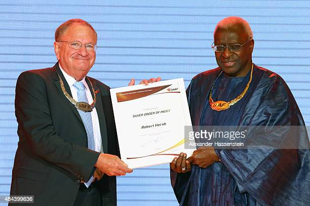 President Lamine Diack hands over the Silver Order of Merit to Robert Hersh during the IAAF Congress Opening Ceremony at the Great Hall of the People...