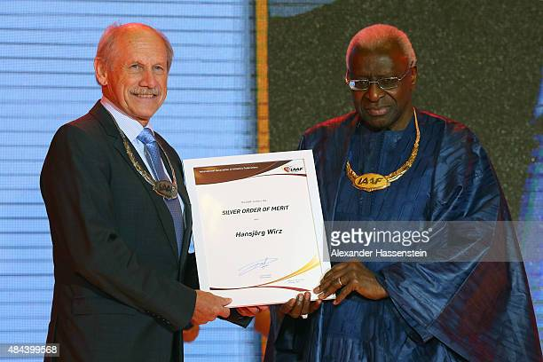 President Lamine Diack hands over the Silver Order of Merit to Hansjoerg Wirz during the IAAF Congress Opening Ceremony at the Great Hall of the...