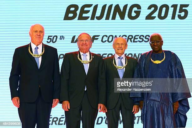 President Lamine Diack poses with the Silver Order of Merit award winner Helmut Digel Robert Hersh and Hansjoerg Wirz during the IAAF Congress...