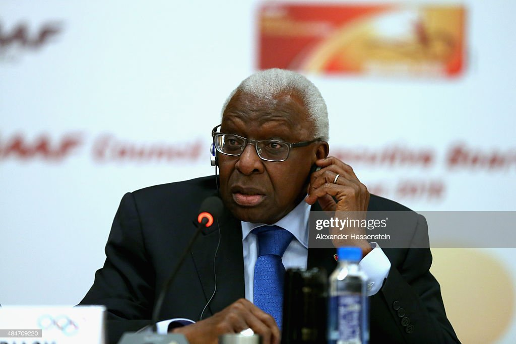 President Lamine Diack talks to the media during a press conference after the IAAF Council and IOC Executive Board meeting at Intercontinental Beijing Beichen Hotel on August 21, 2015 in Beijing, China.