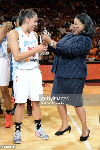 President Laurel J Richie presents Shoni Schimmel of the Eastern Conference AllStars with the WNBA All Star MVP trophy after the 2014 Boost Mobile...