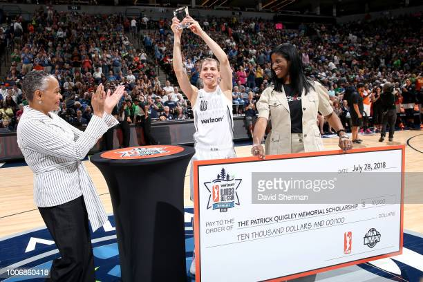 President Lisa Borders presents Allie Quigley of the Chicago Sky with the Trophy during the ThreePoint Contest during halftime during the Verizon...
