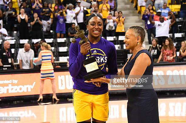 President Lisa Borders presents the trophy to Nneka Ogwumike of the Los Angeles Sparks who is named the 2016 WNBA Most Valuable Player presented by...