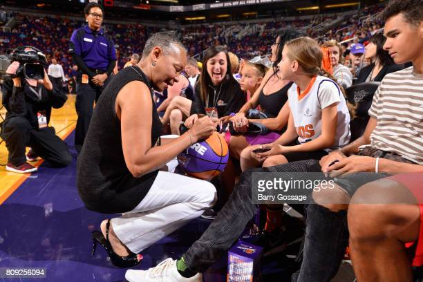President Lisa Borders signs an autograph for a fan before the game between the Phoenix Mercury and the Los Angeles Sparks during a WNBA game on June...