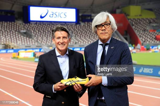 President Lord Sebastian Coe poses with Naoki Matsushita of Asics following a press conference prior to the 17th IAAF World Athletics Championships...