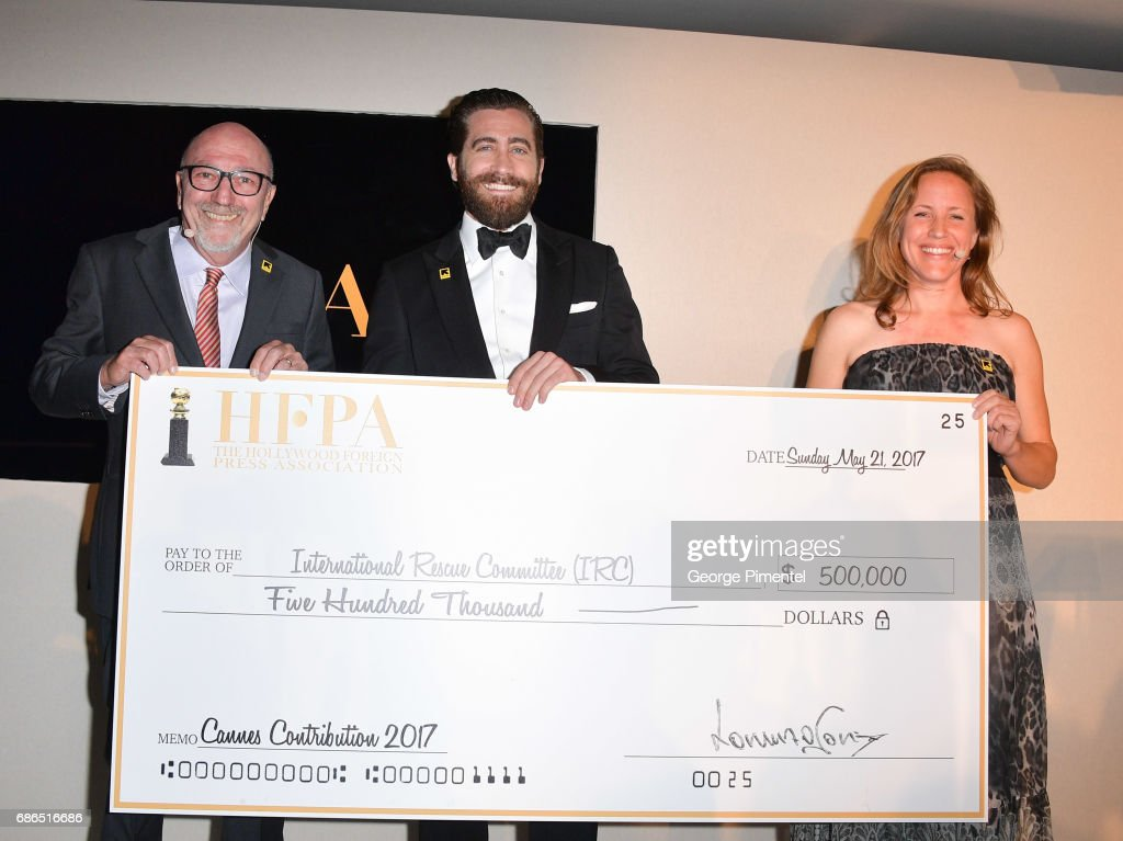 President Lorenzo Soria, Jake Gyllenhaal and International Rescue Committee Eilnor Raikes attend the Hollywood Foreign Press Association's 2017 Cannes Film Festival Event in honour of the International Rescue Committee during the 70th Annual Cannes Film Festival on May 21, 2017 in Cannes, France.