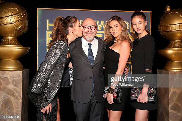 HFPA president Lorenzo Soria poses with 2016 Miss Golden Globes Sistine Stallone Sophia Stallone and Scarlet Stallone at the Hollywood Foreign Press...