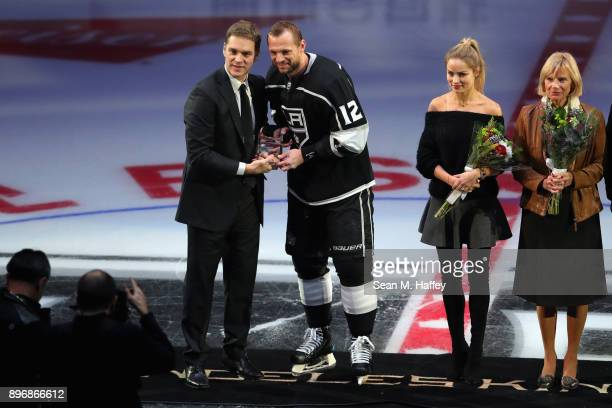 President Luc Robitaille presents Marian Gaborik of the Los Angeles Kings with an award for one thousand games played in the NHL prior to the first...