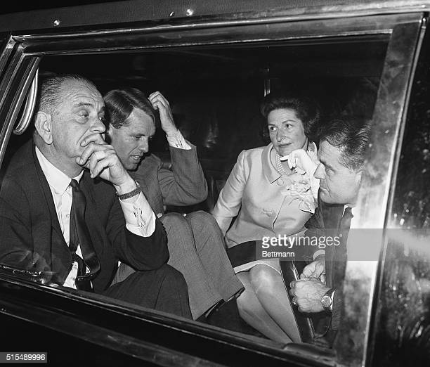 President Lyndon B Johnson and Democratic Senatorial candidate Robert Francis Kennedy ponder over a puzzling point as they sit in the President's car...