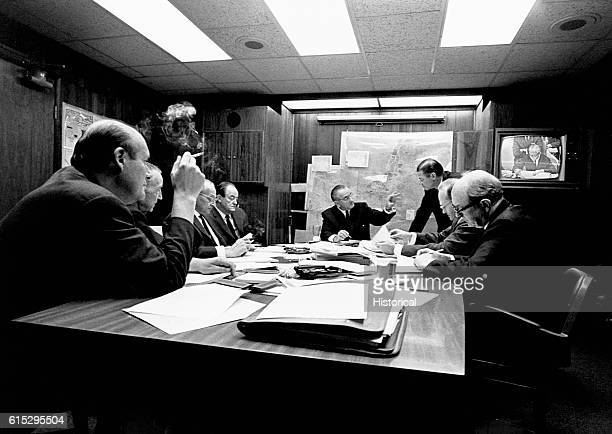 President Lyndon B Johnson and key advisors discuss issues in the Situation Room during the Six Day War after Washington communicated with Moscow on...