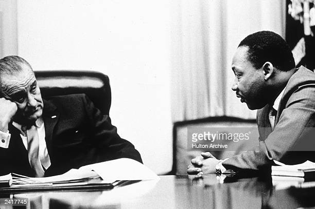 President Lyndon B Johnson discusses the Voting Rights Act with civil rights campaigner Martin Luther King Jr . The act, part of President Johnson's...