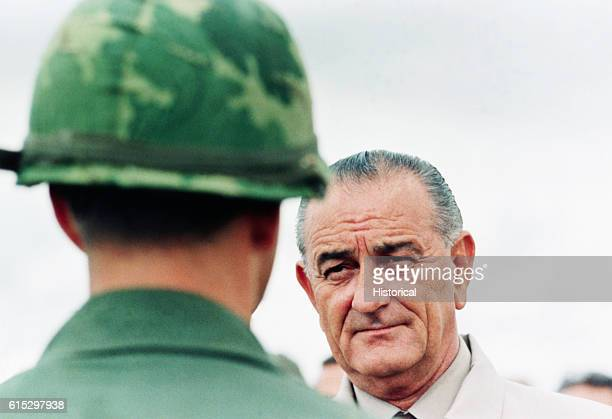 President Lyndon B. Johnson meets soldiers during a surprise visit to an American base in Cam Rahn Bay in South Vietnam. October 1966.