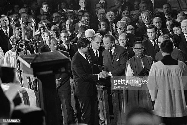 President Lyndon B Johnson shakes hands with Senator Edward Kennedy following a Requiem Mass for Senator Robert Kennedy in St Patrick's Cathedral In...