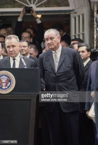 President Lyndon B Johnson stands next to Soviet Premier Alexei Kosygin as he makes a speech during the Glassboro Summit Conference on Soviet-US...