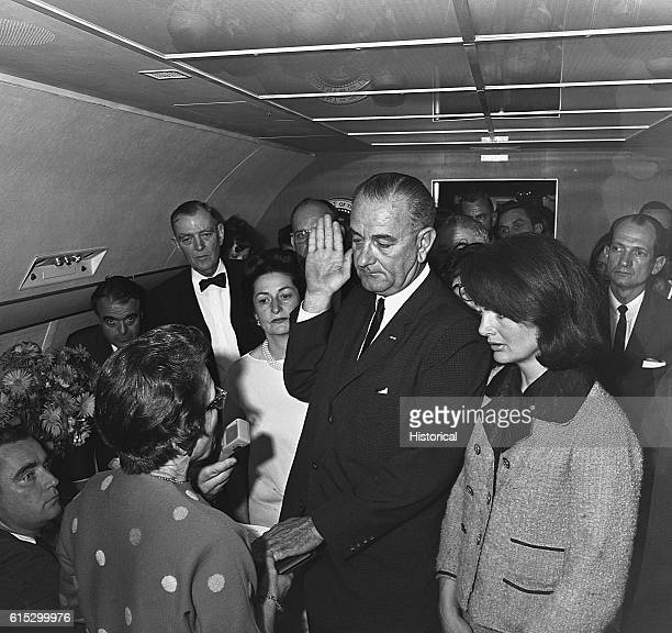 President Lyndon B Johnson takes the oath of office aboard Air Force One after the assassination of John F Kennedy Kennedy's wife Jacqueline and...