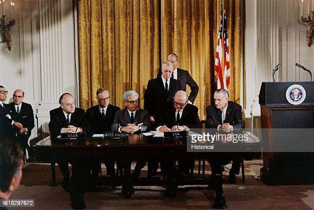 President Lyndon B Johnson watches the signing of an international treaty banning weapons in outerspace January 27 1967 the same day three astronauts...