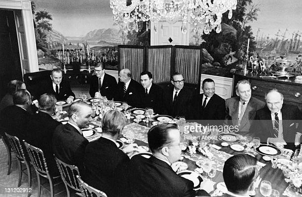 US President Lyndon Baines Johnson hosts a dinner meeting in the White House Washington DC 1960s Among the attendees is American newspaper publisher...