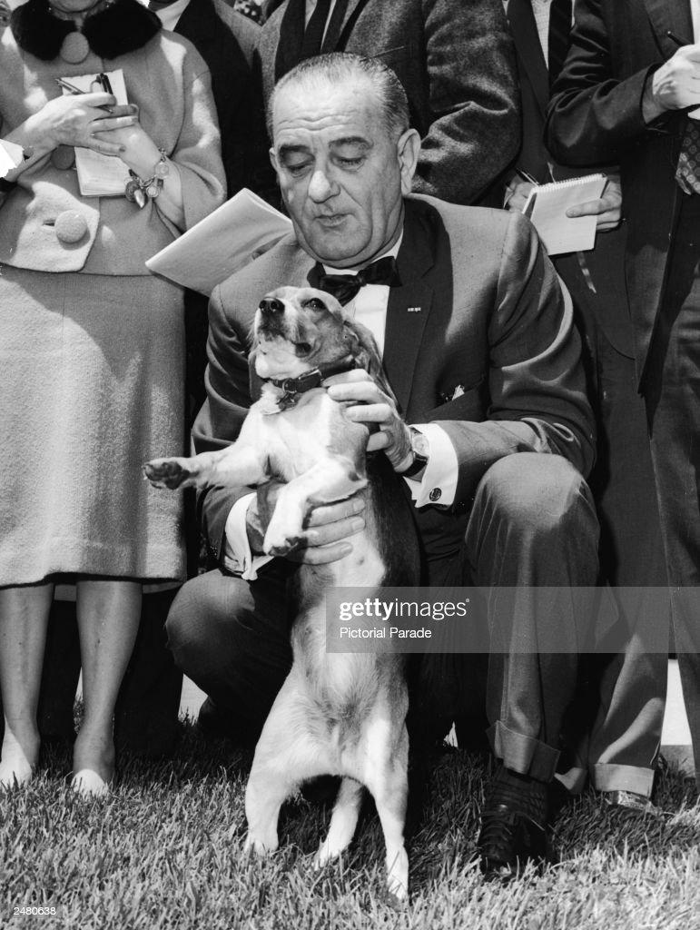 LBJ Kneeling With Pet Beagle 'Him' : News Photo