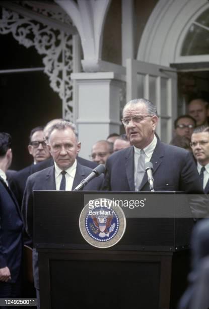 President Lyndon Johnson and Aleksej Nikolaevič Kosygin speaking at the podium at Glassboro Summit, Glassboro, NJ, June 1967.
