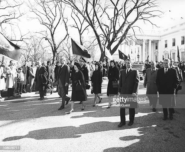 US President Lyndon Johnson and his wife First Lady Lady Bird Johnson acccompanied by their daughters Luci and Lynda march in the funeral procession...