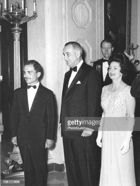 US President Lyndon Johnson and his wife First Lady Lady Bird Johnson pose with King Hussein of Jordan Washington DC April 14 1964