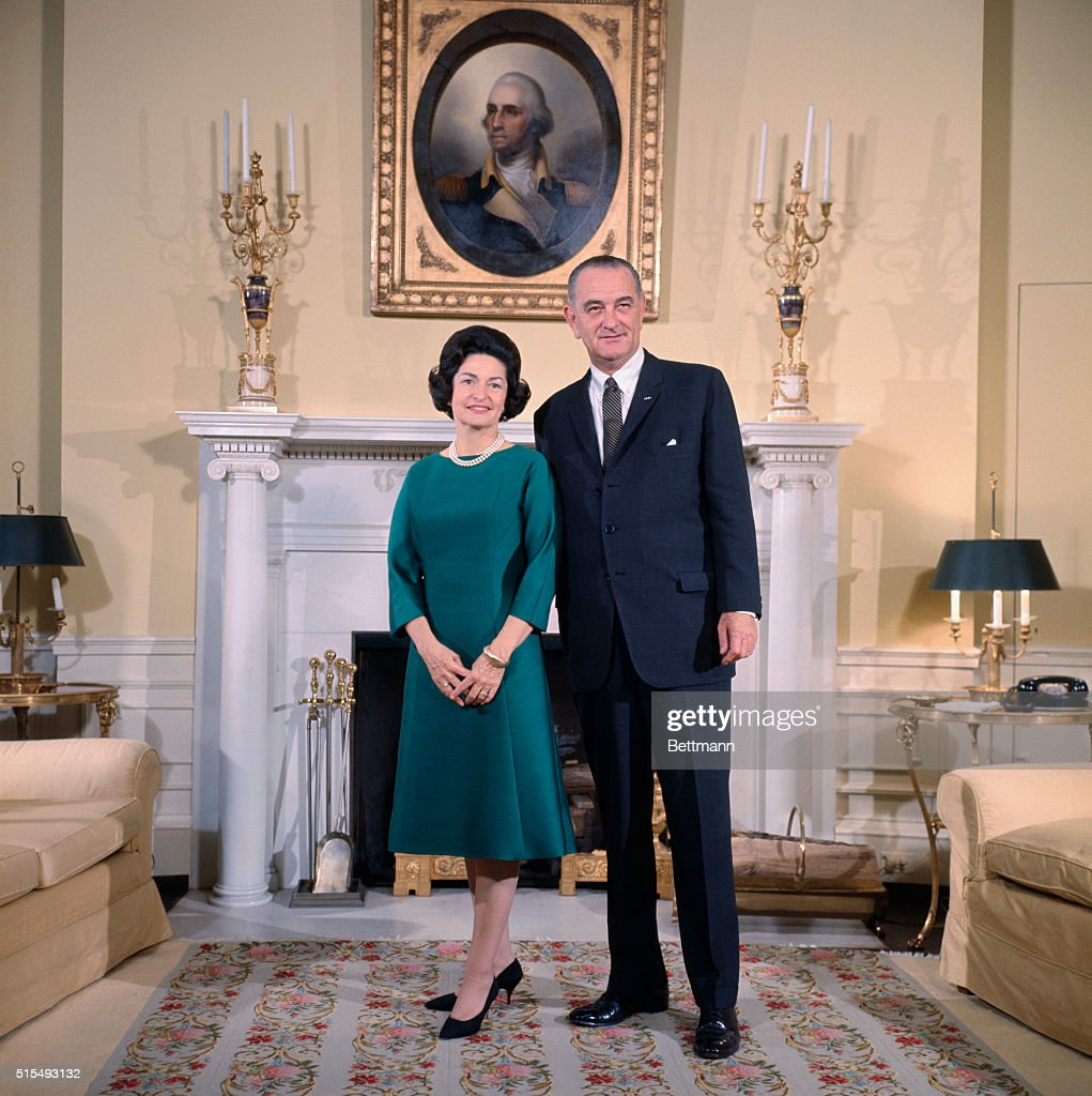 President Lyndon Johnson and Lady Bird Johnson stand in the Yellow Oval Room of the White House for a pre-inauguration photograph.