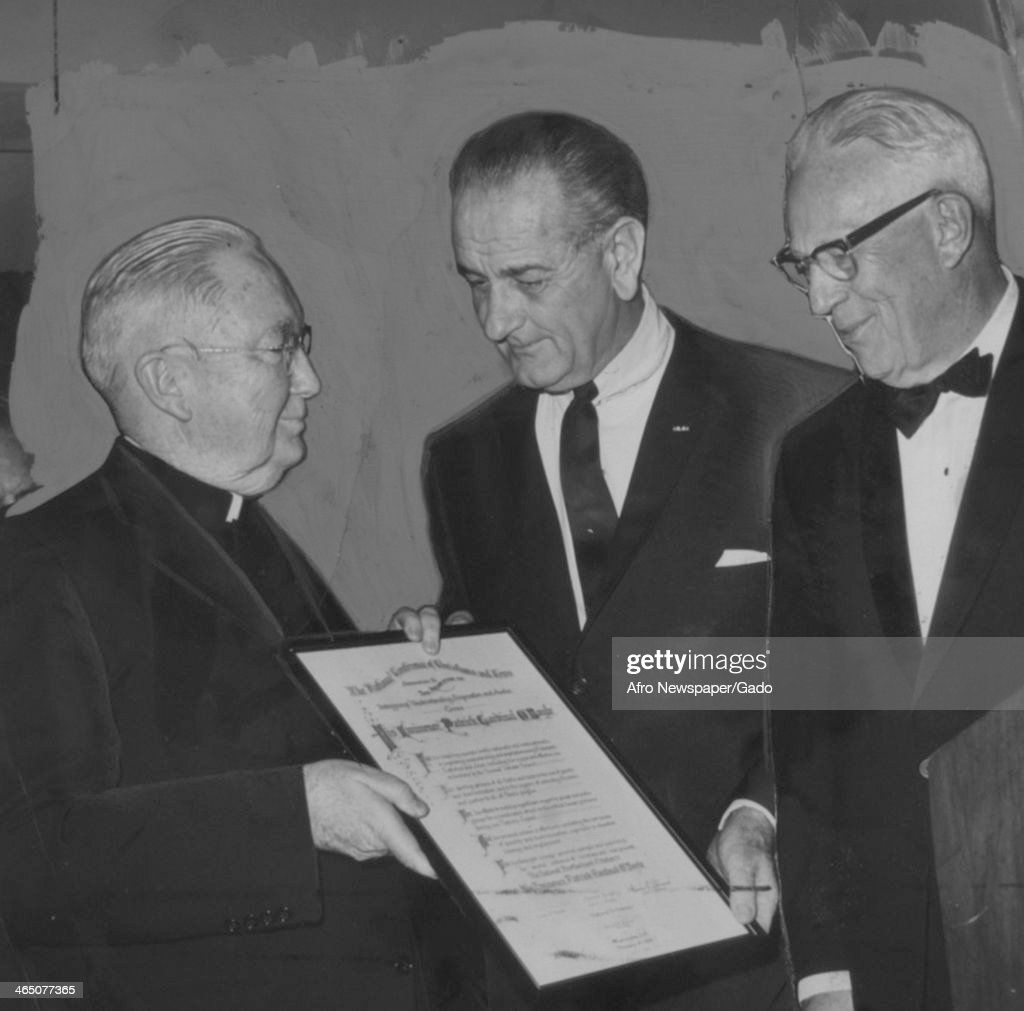 President Lyndon Johnson and United States Supreme Court Chief Justice Carl Warren present an award for improving racial understanding to Patrick O'Doyle, February 24, 1968.