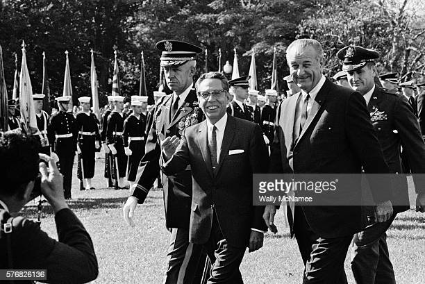 President Lyndon Johnson escorts visiting Mexican President, Gustavo Diaz Ordaz to the reviewing stand for honors and speeches.