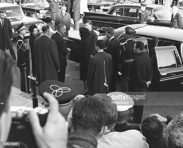 US President Lyndon Johnson holds the hand of widow Jacqueline Kennedy following the brief service for her husband assassinated President John F...