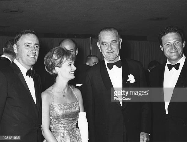 US President Lyndon Johnson poses with American actress and singer Florence Henderson and comedy duo Dick Martin and Dan Rowan of television show...