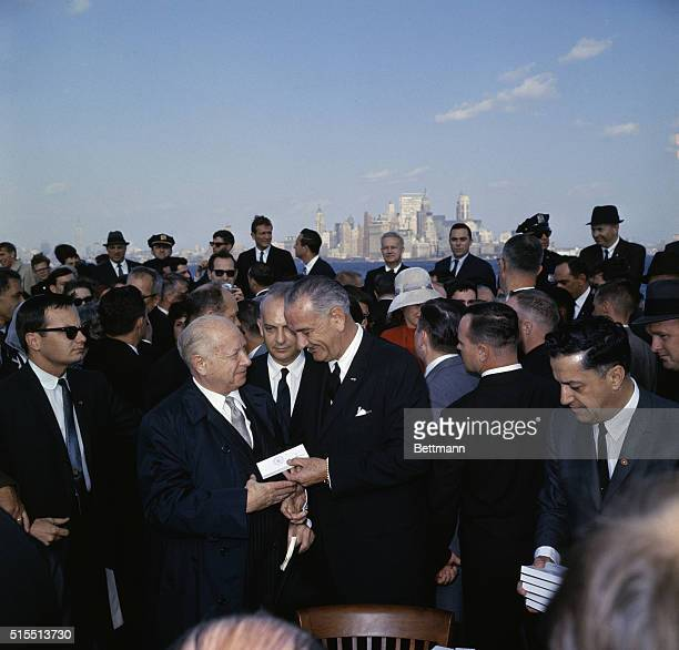 President Lyndon Johnson shakes hands with David Dubinsky president of the International Ladies Garment Workers Union today October 3rd at Liberty...