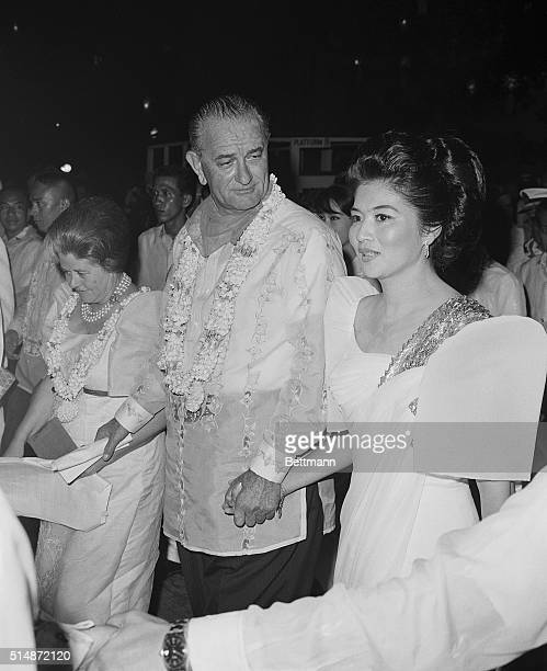 U S President Lyndon Johnson walks with Philippines First Lady Imelda Marcos to dinner in Malcanang Palace during his visit to Manila | Location...