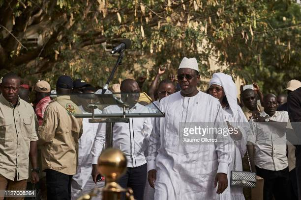 President Macky Sall approaches a stand to speak to the media after casting his vote at a polling station on February 24 2019 in Fatick Senegal 67...