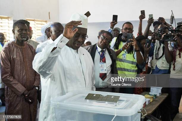 President Macky Sall casts his vote at a polling station on February 24 2019 in Fatick Senegal 67 million voters are expected to cast their vote in...