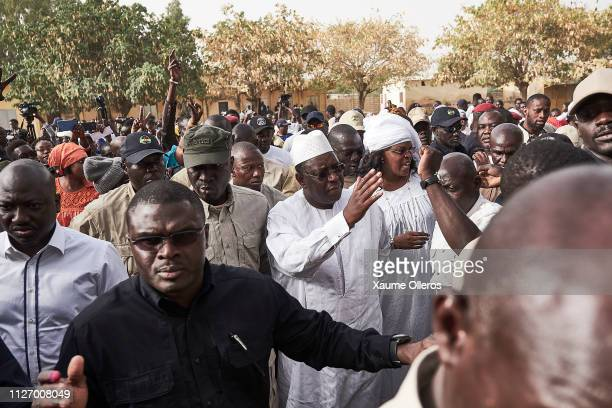 President Macky Sall greets the crowd as he leaves the polling station after casting his vote on February 24 2019 in Fatick Senegal 67 million voters...